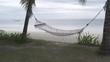 Hammock swings against sea
