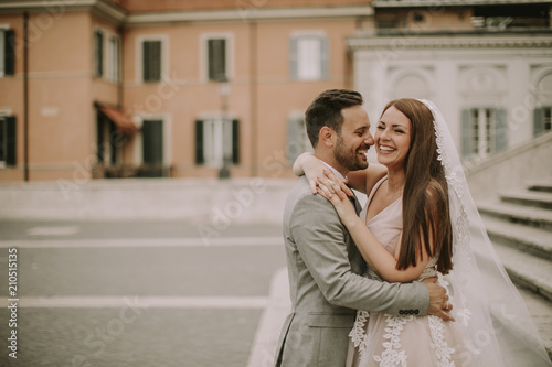 Young wedding couple on Spanish stairs in Rome Canvas Print