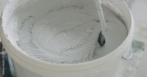 Fotografie, Obraz  closeup mixing gray decorative concrete plaster