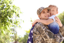 American Soldier With Her Son Outdoors. Military Service