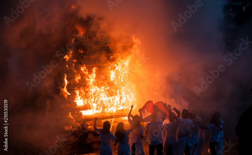 retail of silhouette of people  in front of bonfire