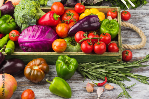 Fotografie, Obraz  Set of different fresh raw colorful vegetables in the wooden tray