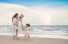 Parent's Hands And Daughter Holding Private Property In Sea Beach