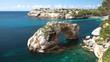 View of natural rock arch at the coast of Majorca, natural landmark Es Pontas, Spain Mediterranean Sea, Balearic Islands