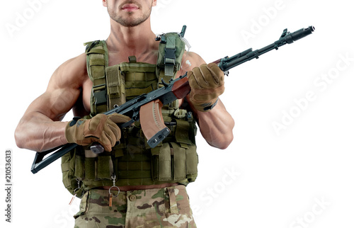 Poster Militaire Muscular young soldier keeping firearm wearing body armour.Looking strong and fit, having muscular body. Posing on white studio background.