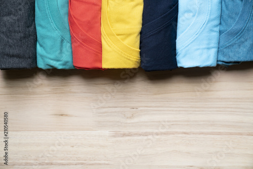 Fotografie, Obraz  close up of rolled colorful clothes on table background