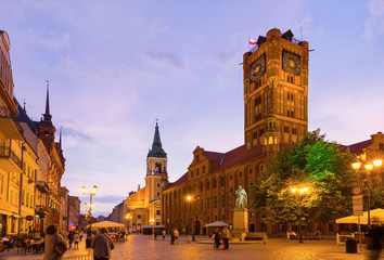 Torun Town Hall and monument of Copernicus at night