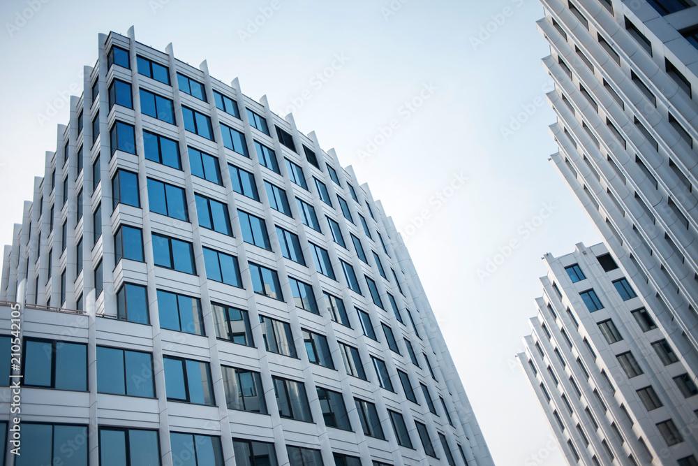 Fototapeta facade of white buildings in the business quarter. Not fully glass facades