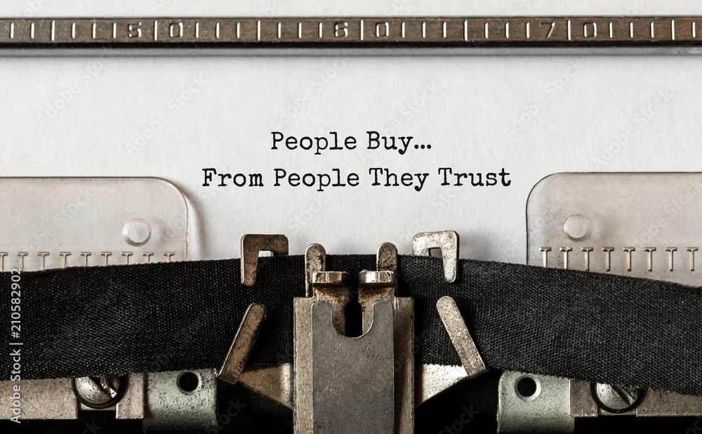 Fototapeta Text People Buy From People They Trust typed on retro typewriter