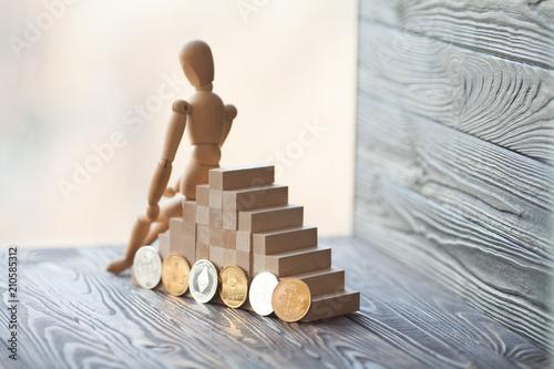 Fotografie, Tablou  wooden mannequin with bitcoins.