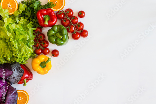 Poster Cuisine Fresh colorful organic vegetables on a white background, farming and healthy food concept. Copy space. Flat lay