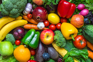 Assortment of fresh harvested fruits and vegetables on the table
