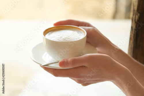 Garden Poster Tea Young woman with cup of delicious coffee on blurred background