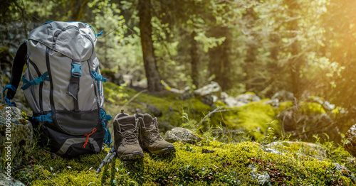 Obraz Backpack and hiking boots in forest - fototapety do salonu