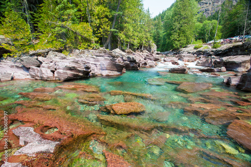 Photo Stands South America Country Glacier National Park. Turquoise river flowing towards Lake McDonald