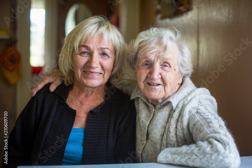 Obraz An elderly woman with her adult daughter. - fototapety do salonu