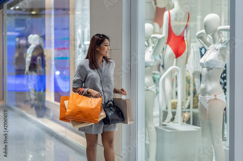 fcfda93db Asian woman walking and looking through the glassess into the underwear on  model display mockup in