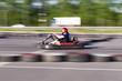 Young men driving karts