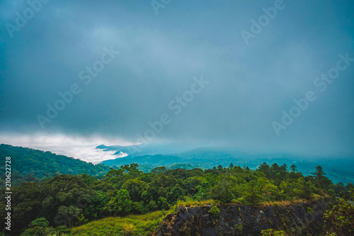 Tuinposter Blauwe jeans high mountains peaks range clouds in fog scenery landscape national park view outdoor at Chiang Rai, Chiang Mai Province, Thailand