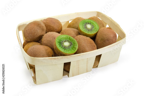 Kiwifruits in wooden basket on a white background