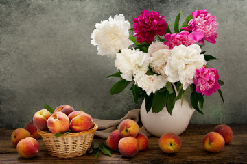 still life with a bouquet of peonies and peaches