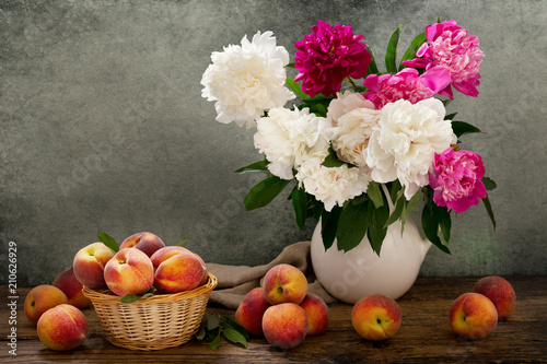 Fototapeta still life with a bouquet of peonies and peaches obraz