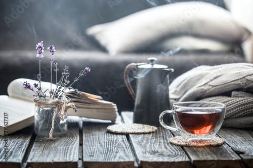 Foto op Canvas Herfst still life book and a cup of tea in the living room