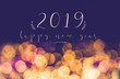 canvas print picture - handwriting 2019 happy new year on vintage blur festive bokeh light background,holiday greeting card.