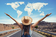 Happy travel woman on vacation concept with world shaped clouds. Funny traveler enjoy her trip and ready to adventure.