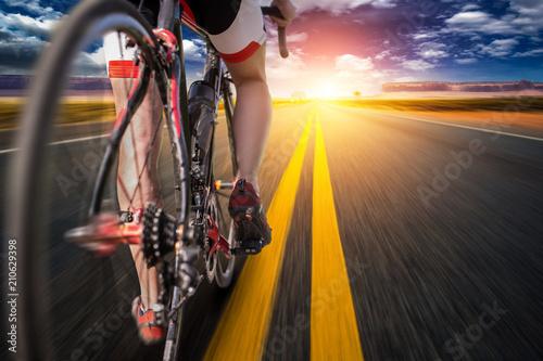 Papiers peints Kiev Cyclist on bike path, view from the rear wheel
