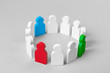 Concept leader of a business team. Crowd of white men stands in circle and listens to the leader of blue and red and green