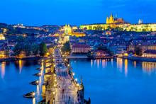 View Of Charles Bridge, Prague Castle And Vltava River In Prague, Czech Republic During Blue Hour