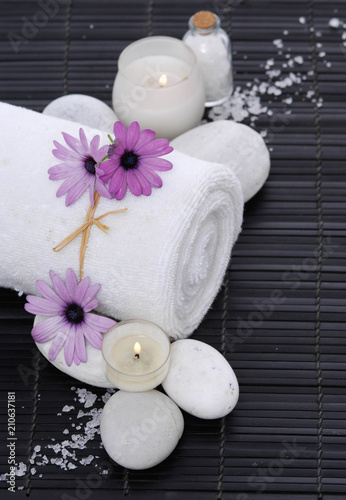 Spoed Foto op Canvas Spa Spa setting with candle, rolled towel , Magnolia , salt, stoneson on mat