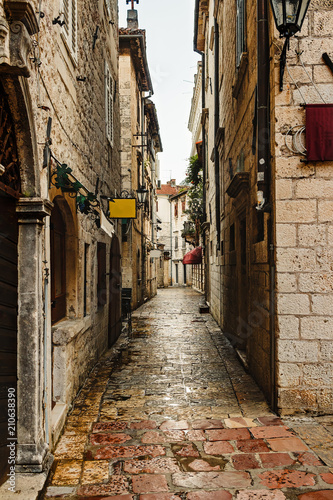Poster Smal steegje Narrow european street with old historical buildings in the ancient town Kotor in Montenegro
