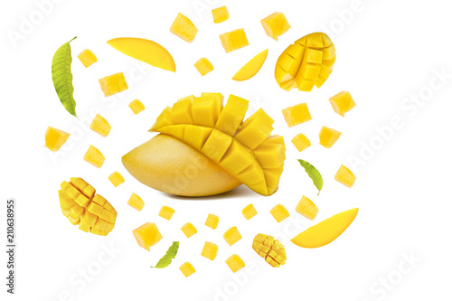 Mango tropical fruit with cubes and leaf flying on isolated white background