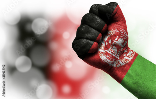 Flag of Afghanistan painted on male fist,strength Wallpaper Mural