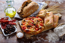 Focaccia Barese With Cherry Tomatoes And Olives. Olive Bread, White Focaccia, Dried Tomatoes And Olives