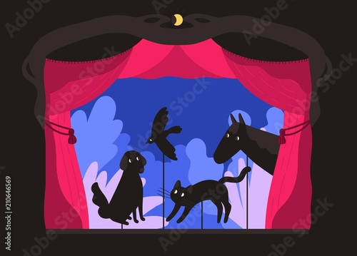 Photo  Rod shadow puppets manipulated by puppeteer at theater stage