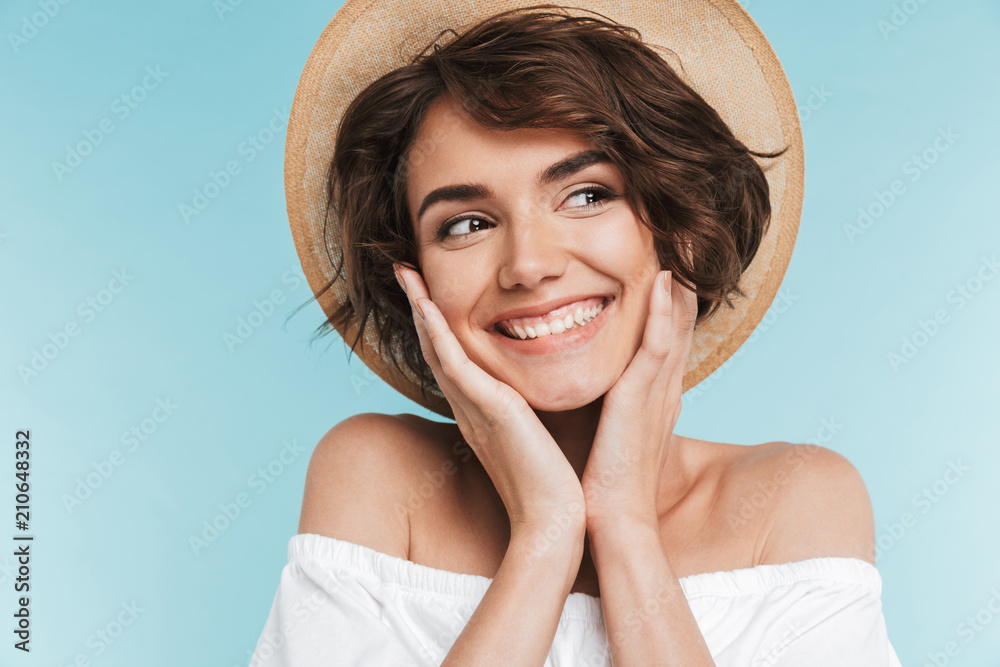 Fototapety, obrazy: Close up of a smiling young woman in summer hat