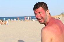 White Man At The Beach During ...