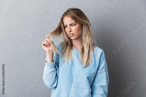 Fotografie, Obraz  Portrait of a depressed young blonde girl