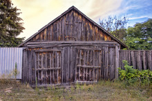 Old Wooden Granary Facade Of A Beautiful Dilapidated Barn
