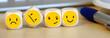 Leinwandbild Motiv Emoticons auf Würfel