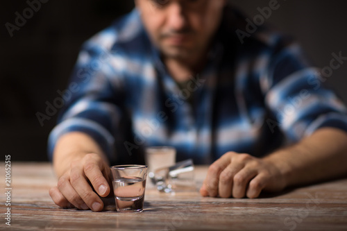Fényképezés  alcoholism, alcohol addiction and people concept - male alcoholic drinking shot