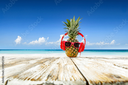 Valokuvatapetti Pineapple on beach and summer time