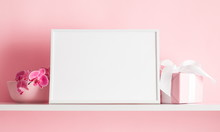 Photo Frame Mock Up, Beautiful Flowers Bouquet On The Shelf, Gift With White Satin Bow, Pink Orchid On Pink Wall Background.