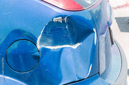 Blue scratched car with damaged paint in crash accident or