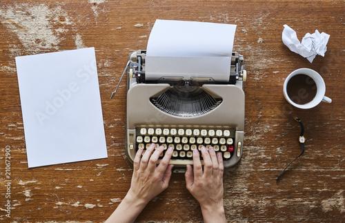 Keuken foto achterwand Retro female hands on keyboard writing a novel and drinking coffee