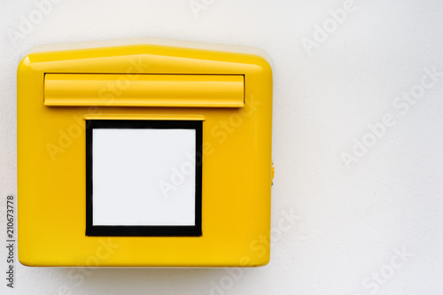 Fotografie, Obraz  Close-up photo of yellow mail box with empty sign