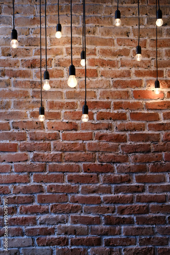 Old red brick wall with bulb lights lamp Canvas Print